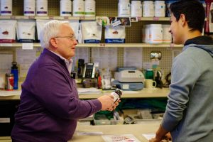Joe Wise at Wise Pharmacy assists a customer